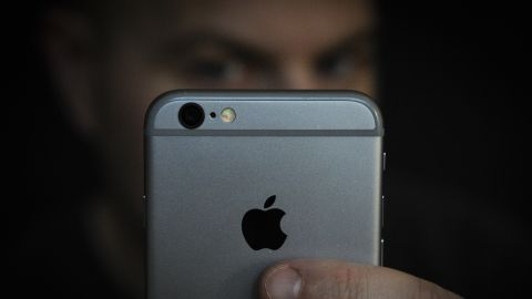 A man is seen using an iPhone on November 2, 2017. Concerns have been raised about Apple's new iPhone X and it's front facing camera with face recognition. Apple allows thrid party developers to store information from facial photographs on it's servers raising security concerns with privacy groups. (Photo by Jaap Arriens/NurPhoto via Getty Images)