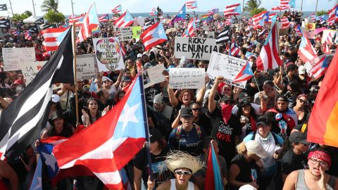 OLD SAN JUAN, PUERTO RICO - JULY 17: Demonstrators protest against Ricardo Rossello, the Governor of Puerto Rico July 17, 2019 in front of the Capitol Building in Old San Juan, Puerto Rico. There have been calls for the Governor to step down after it was revealed that he and top aides were part of a private chat group that contained misogynistic and homophobic messages. (Photo by Joe Raedle/Getty Images)