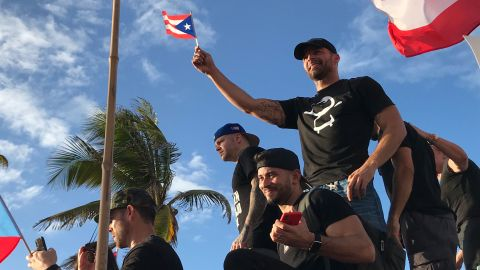 Ricky Martin waves a small Puerto Rican flag as he joined the protest in Puerto Rico.