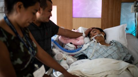 Miguel Gámez, father of Heydi Nallely Gámez Garcia, cries as his sister Jessica Gámez Garcia touchers Heydi's while she lays on life support in Cohen Children's Medical Center in Queens, NY on July 17, 2019.