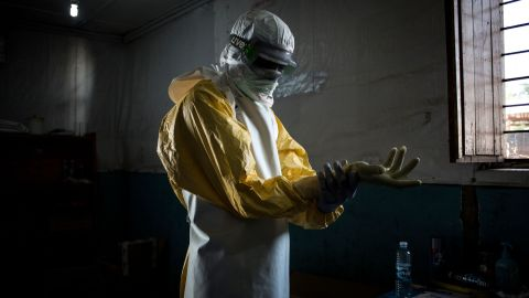 A health worker puts on his personal protective equipment (PPE) before entering the red zone of a MSF (Doctors Without Birders) supported Ebola Treatment Centre (ETC), where he will check up on patients on November 6, 2018 in Bunia, Democratic Republic of the Congo.