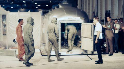 Carpentier, far left, goes into quarantine with the Apollo 11 astronauts.