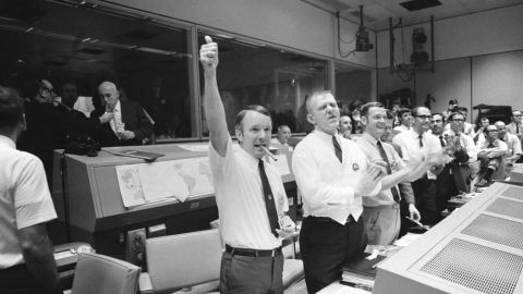Flight directors worked together throughout the Apollo program. Here, Apollo 13 flight directors (left to right) Gerald D. Griffin, Eugene F. Kranz and Glynn S. Lunney celebrate a successful splashdown.