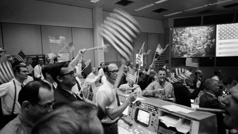 Celebrations of the lunar landing in the Mission Operations Control Room.