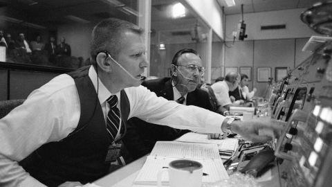 Gene Kranz (left) and Chris Kraft at their consoles.