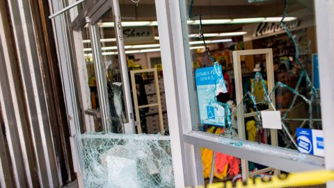 A department store's windows are broken Thursday, after protests the previous night in San Juan.