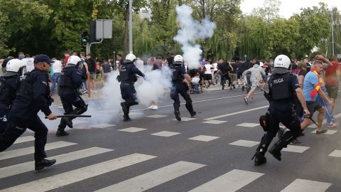 Riot police deployed stun grenades and pepper spray to clear far-right protesters.