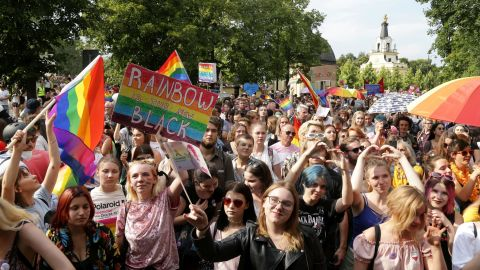 People hold flags and placards during the first gay pride march on July 20, 2019 in the city of Bialystok, in eastern Poland. (Photo by Jerzy Baliski / AFP)        (Photo credit should read JERZY BALISKI/AFP/Getty Images)