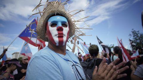 Demonstrators fill the Las Americas Highway in San Juan on Monday.