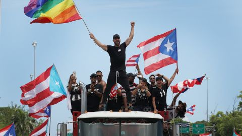 SAN JUAN, PUERTO RICO - JULY 22: Singer Ricky Martin waves a flag as he joins with thousands of other people as they fill the Expreso Las Américas highway calling for the ouster of Gov. Ricardo A. Rosselló on July 22, 2019 in San Juan, Puerto Rico. The protesters are calling on Gov. Rosselló to step down after a group chat was exposed that included misogynistic and homophobic comments. (Photo by Joe Raedle/Getty Images)