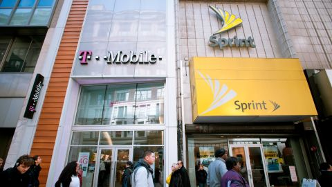 T-Mobile and Sprint Nextel cellular phone stores adjoin each other in Herald Square in New York on Tuesday, March 8, 2011. Sprint announced ti is cutting 2500 jobs, approximately 7 percent of its workers, and closing call centers in a $2.5 billion cost cutting endeavor. (Photo by Richard Levine/Corbis via Getty Images)