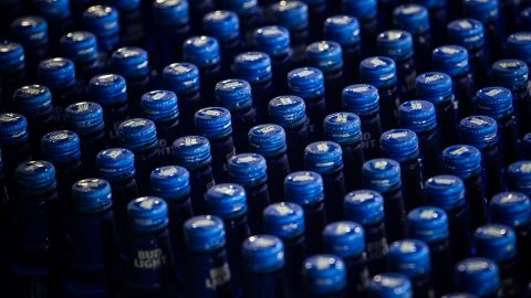 """Aluminum bottles of Bud Light brand beer move along a conveyor at an Anheuser-Busch InBev NV facility in St. Louis, Missouri, U.S., on Monday, July 16, 2018. """"Because beer is increasingly packaged in aluminum cans, the proposed 10 percent tariff on aluminum will likely cost U.S. brewers millions of dollars,"""" the company said in a statement. Photographer: Alex Flynn/Bloomberg via Getty Images"""