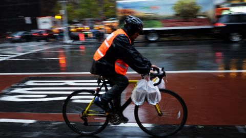 Food delivery companies are facing  scrutiny over how workers are paid. (Jewel Samad/AFP/Getty Images)