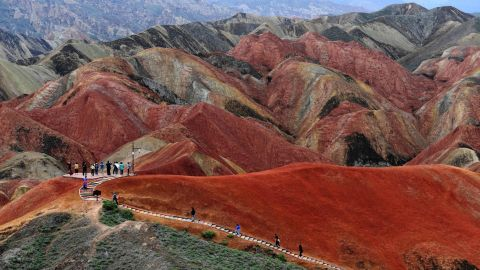 <strong>Zhangye National Geopark:</strong> Zhangye National Geopark in Gansu, China, is famous for its Danxia landform. It's a stunning landscape of red-colored sandstone formed in the Cretaceous age.