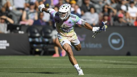 Team Baptiste's Paul Rabil carries the ball in the Premier Lacrosse League All-Star game.
