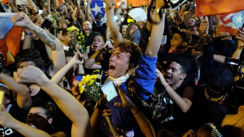 """Demonstrators celebrate after the resignation message of the governor of Puerto Rico, Ricardo Rossello in front his mansion known as La Fortaleza in San Juan, on July 24, 2019. - Puerto Rico's embattled governor Ricardo Rossello announced his resignation late Wednesday, July 24, 2019, following two weeks of massive protests triggered by the release of a chat exchange in which he and others mocked gays, women and hurricane victims. """"I announce that I will be resigning from the governor's post effective Friday, August 2 at 5 pm,"""" Rico said, in a video broadcast by the government. (Photo by Ricardo ARDUENGO / AFP)        (Photo credit should read RICARDO ARDUENGO/AFP/Getty Images)"""