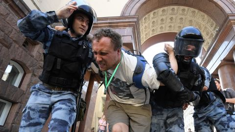 Members of the Russian National Guard detain a protester during an unauthorised rally in downtown Moscow on July 27, 2019.