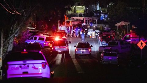 Police vehicles arrive on the scene following a deadly shooting at the Gilroy Garlic Festival on Sunday.