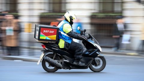 A food delivery courier, working for Just Eat Plc, travels in London, U.K., on Thursday, Dec. 22, 2016. The food delivery business model has proven attractive to venture capitalists, who last year poured $5.5 billion into food-delivery companies globally, according to research firm CB Insights. Photographer: Simon Dawson/Bloomberg via Getty Images