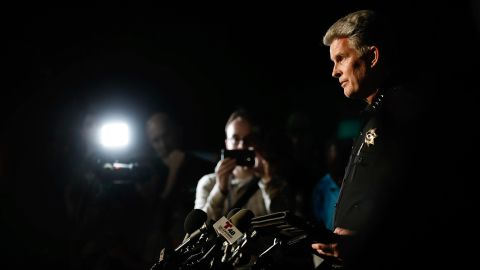 Gilroy Police Chief Scot Smithee talks to the media at a reunification center at Gavilan College.