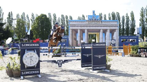 Germany's Ludger Beerbaum and Cool Feeling missed out by just 0.35 seconds.
