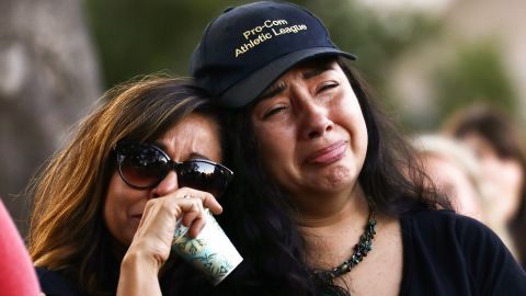 People embrace at a vigil for victims of the mass shooting at the Gilroy Garlic Festival on July 29, 2019 in Gilroy, California.