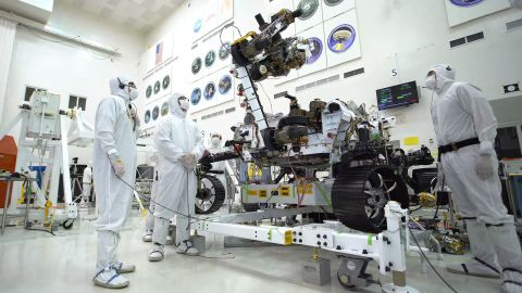 The Mars 2020 rover's 7-foot-long arm simulates a bicep curl with an 88 pound sensor-laden turret.