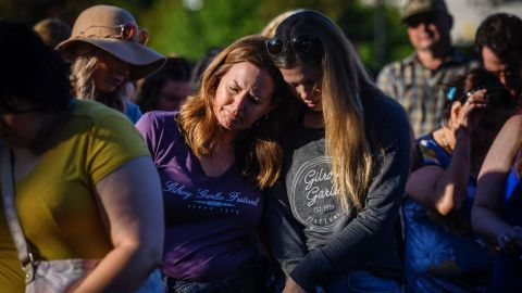 Kirstin Bright, left, leans on Jessica Bright during a vigil at the Gilroy Police Department in California on Monday, July 29. Kirstin was at the Gilroy Garlic Festival during the deadly shooting on Sunday.