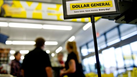 Customers are helped at a Dollar General Corp. store in Creve Coeur, Illinois, U.S., on Thursday, May 31, 2012. U.S. consumer spending rose in April, a sign that households are supporting the economy as the labor market seeks to gain momentum. Dollar General Corp. is scheduled to announce quarterly earnings on June 4. Photographer: Daniel Acker/Bloomberg via Getty Images