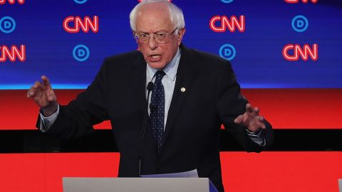 DETROIT, MICHIGAN - JULY 30: Democratic presidential candidate  Sen. Bernie Sanders (I-VT) (C) speaks while South Bend, Indiana Mayor Pete Buttigieg (L) and Sen. Elizabeth Warren (D-MA) listen during the Democratic Presidential Debate at the Fox Theatre July 30, 2019 in Detroit, Michigan. 20 Democratic presidential candidates were split into two groups of 10 to take part in the debate sponsored by CNN held over two nights at Detroit's Fox Theatre.  (Photo by Justin Sullivan/Getty Images)