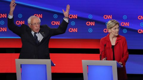DETROIT, MICHIGAN - JULY 30: Democratic presidential candidate Sen. Bernie Sanders (I-VT) (L) gestures while former Colorado governor John Hickenlooper (R) speaks and Sen. Elizabeth Warren (D-MA) and former Texas congressman Beto O'Rourke listen during the Democratic Presidential Debate at the Fox Theatre July 30, 2019 in Detroit, Michigan. 20 Democratic presidential candidates were split into two groups of 10 to take part in the debate sponsored by CNN held over two nights at Detroit's Fox Theatre.  (Photo by Justin Sullivan/Getty Images)