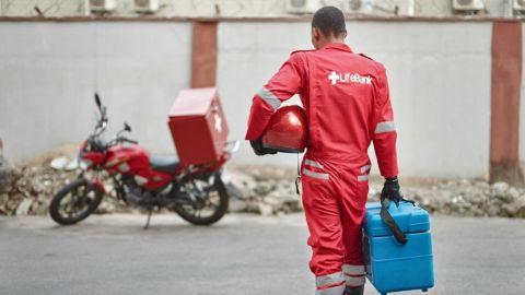 Joseph Kalu, motorbike dispatcher for Lifebank prepares for a delivery.