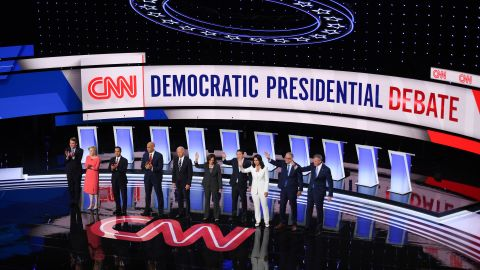 Presidential candidates wave from the stage of Detroit's Fox Theatre during CNN's Democratic debates in July.