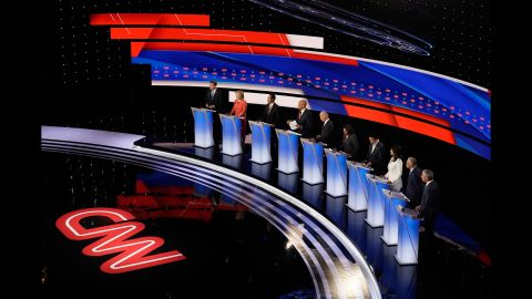 Presidential candidates Michael Bennet, Kirsten Gillibrand, Julián Castro, Cory Booker, Joe Biden, Kamala Harris, Andrew Yang, Tulsi Gabbard, Jay Inslee and Bill de Blasio participate in the CNN Democratic debate in Detroit on Wednesday, July 31.