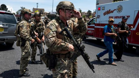 """Law enforcement agencies respond to an active shooter at a Wal-Mart near Cielo Vista Mall in El Paso, Texas, Saturday, Aug. 3, 2019. - Police said there may be more than one suspect involved in an active shooter situation Saturday in El Paso, Texas. City police said on Twitter they had received """"multi reports of multipe shooters."""" There was no immediate word on casualties. (Photo by Joel Angel JUAREZ / AFP)        (Photo credit should read JOEL ANGEL JUAREZ/AFP/Getty Images)"""