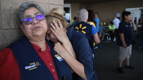 Walmart employees react Saturday after the shooting in El Paso.