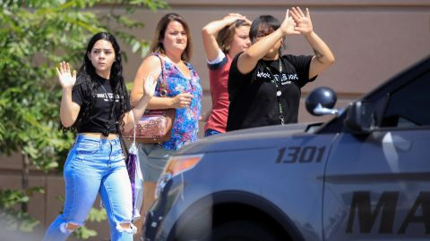 Shoppers exit with their hands up after a mass shooting at a Walmart in El Paso, Texas, U.S. August 3, 2019. REUTERS/Jorge Salgado NO RESALES. NO ARCHIVES.