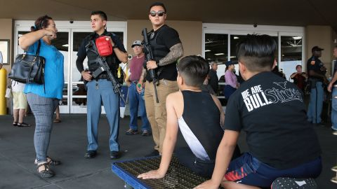Police speak to witnesses at a nearby Sam's Club in El Paso.