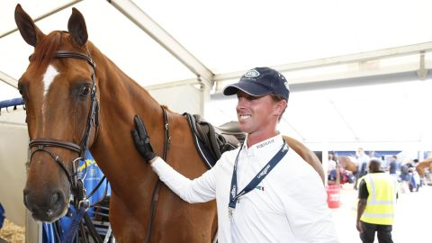 """Ben Maher, seen here sharing a moment with Explosion W, said the Dutch warmblood is """"one of the best"""" horses he has ever had."""