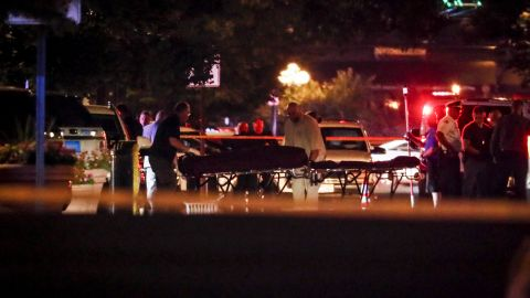 Bodies are removed from the scene of the mass shooting in Dayton.