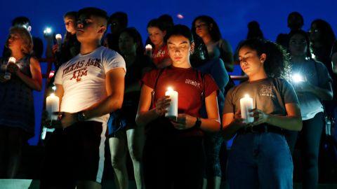 From left, Samuel Lerma, Arzetta Hodges and Desiree Quintanar attend a vigil in El Paso on Saturday.