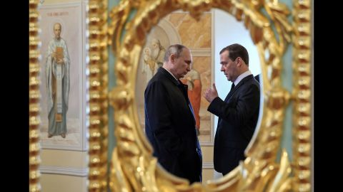 Putin and Medvedev speak while visiting the New Jerusalem Orthodox Monastery outside the town of Istra, Russia, in November 2017.