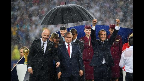 Putin stands with FIFA President Gianni Infantino, left, and French President Emmanuel Macron, right, after the 2018 World Cup final in Moscow. France defeated Croatia in the final.