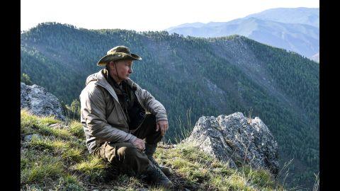 Putin surveys the Sayano-Shushensky Nature Reserve in Siberia in August 2018.