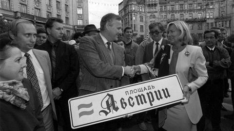 From 1991 to 1994, Putin served as the chairman of St. Petersburg's Foreign Relations Committee. He also served as the city's deputy mayor. Here, Putin stands with St. Petersburg Mayor Anatoly Sobchak during a ceremony in September 1992.