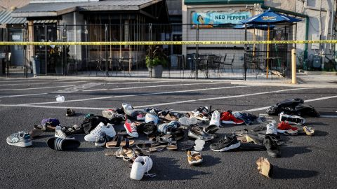 Shoes, hats and other items are piled together outside a bar in Dayton on Sunday.