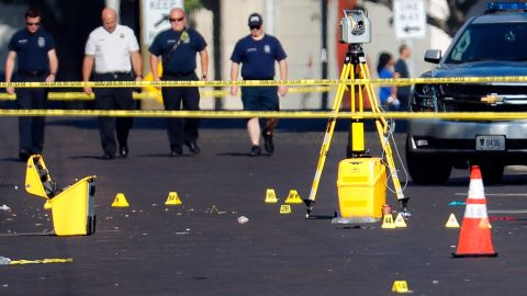 Evidence markers sit in a Dayton street on Sunday.