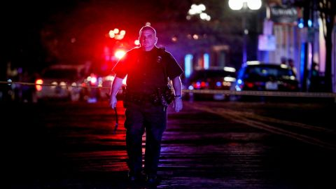 Authorities work at the scene of a mass shooting, Sunday, Aug. 4, 2019, in Dayton, Ohio. Several people in Ohio have been killed in the second mass shooting in the U.S. in less than 24 hours, and the suspected shooter is also deceased, police said. (AP Photo/John Minchillo)