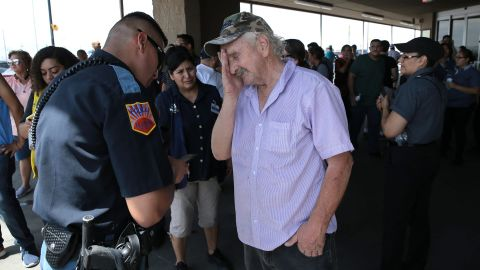 An El Paso police officer interviews a witness after the shooting.