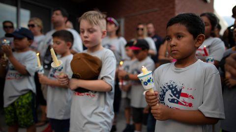 Children participate in an El Paso vigil Sunday.